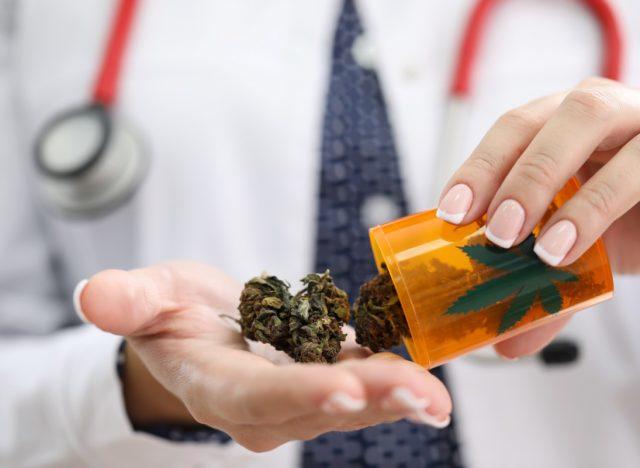 Female GP holding on palm medical marijuana