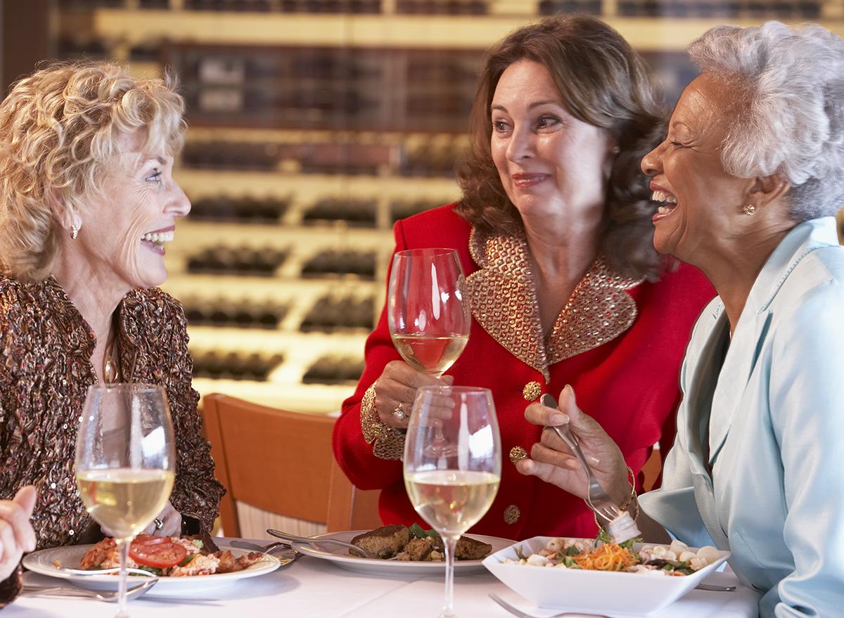 older woman eating dinner in a restaurant