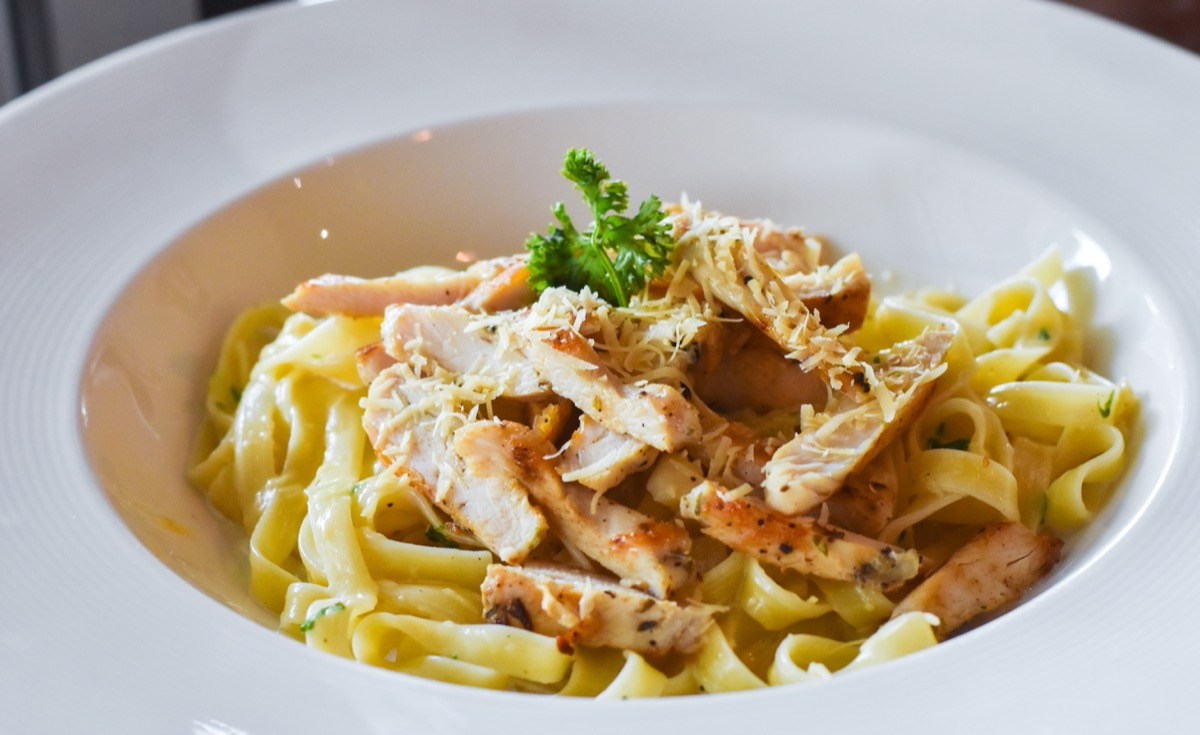 pasta with chicken in white bowl