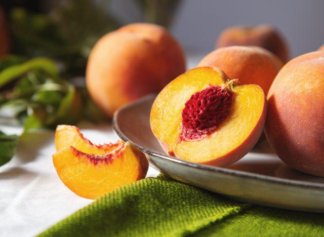 peaches sliced on table