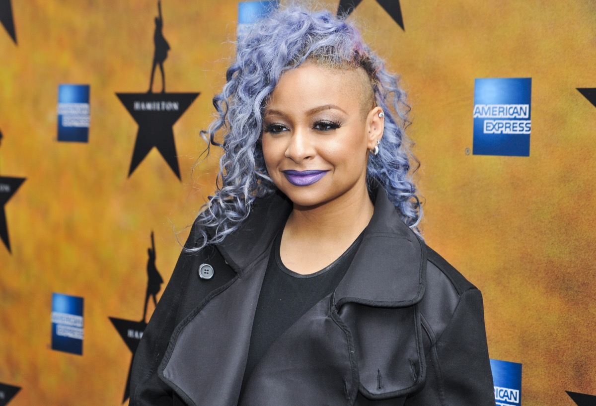 raven symone on red carpet with purple curls