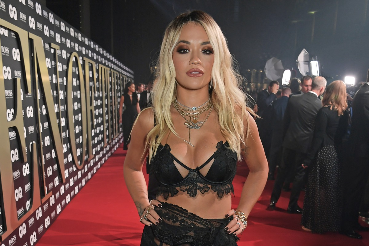 rita ora in black lace outfit on red carpet