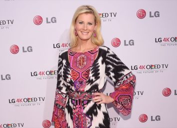 sandra lee in pink dress with black and white details