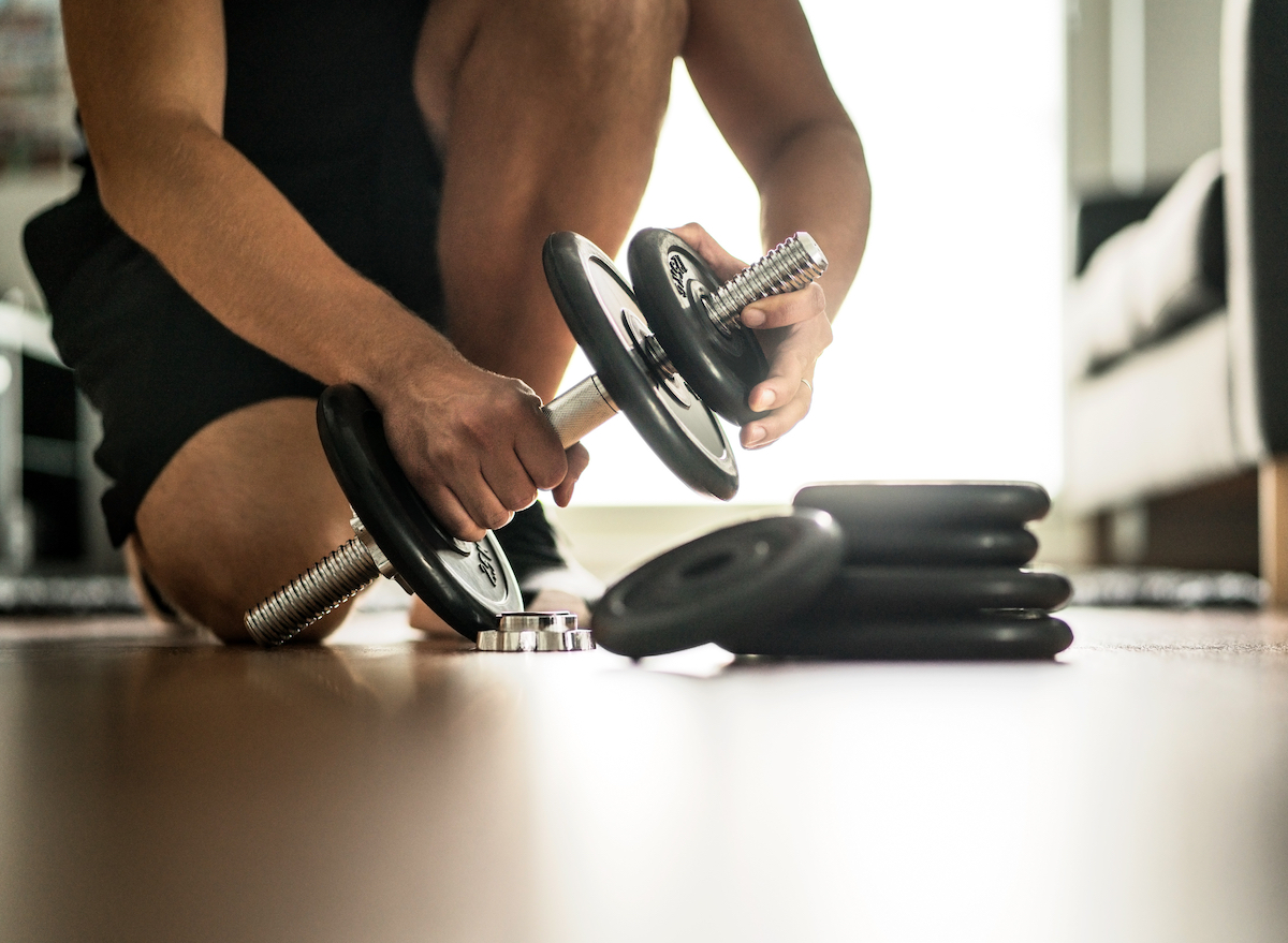 adding weight to a large dumbbell