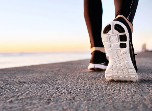 athlete-walking-on-pavement-shoe-closeup