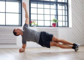 man-doing-side-planks-at-home