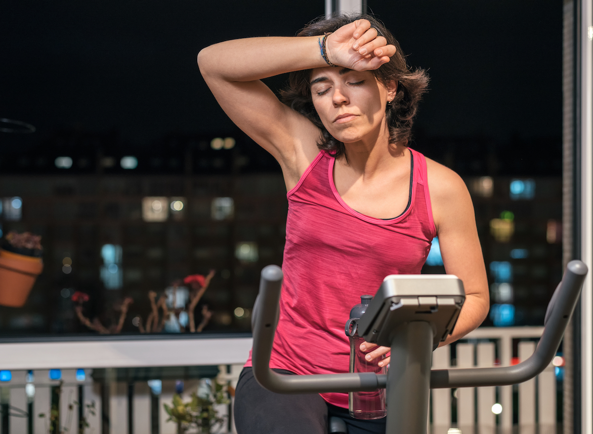 woman doing spin workout at night