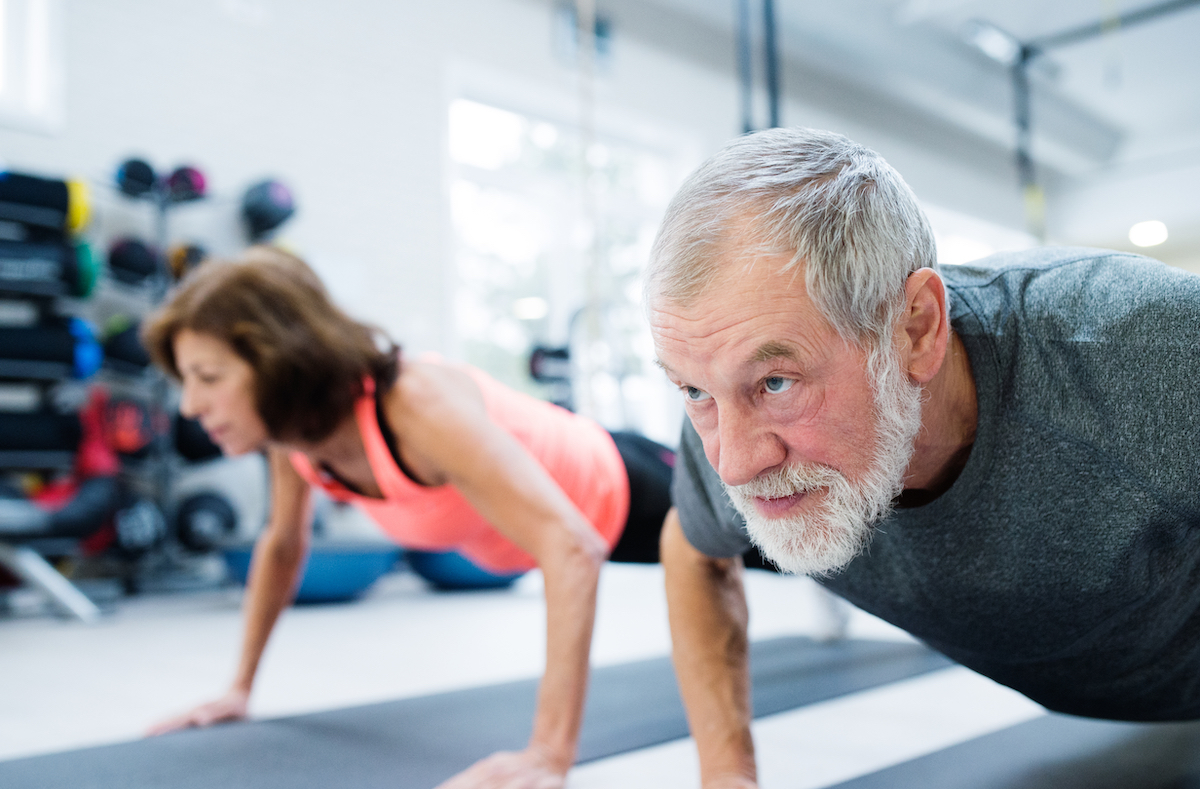 older-man-and-woman-doing-plank-exercises