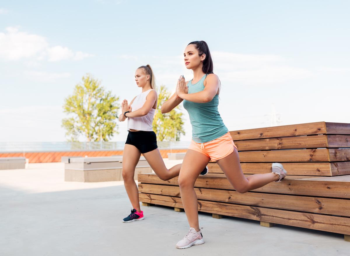 women doing bulgarian split squat exercises outside