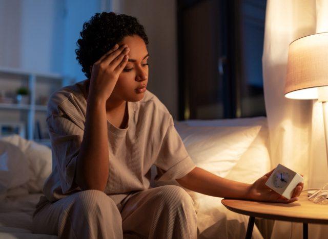 20- or 30-something woman awake at night