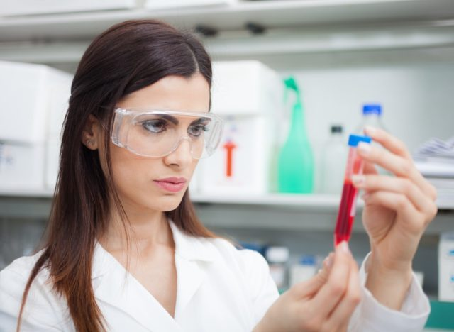 Scientist examining a test-tube in a laboratory