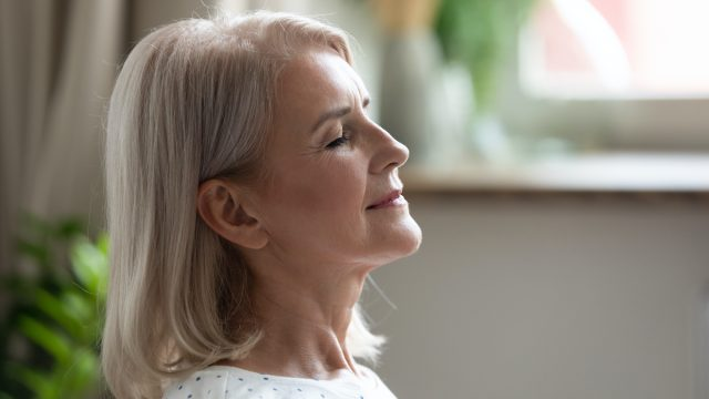 woman over 50 breathing exercise