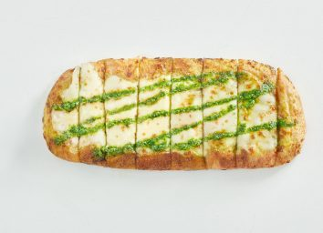 This National Pizza Chain Just Launched a Game-Changing New Cheesy Bread