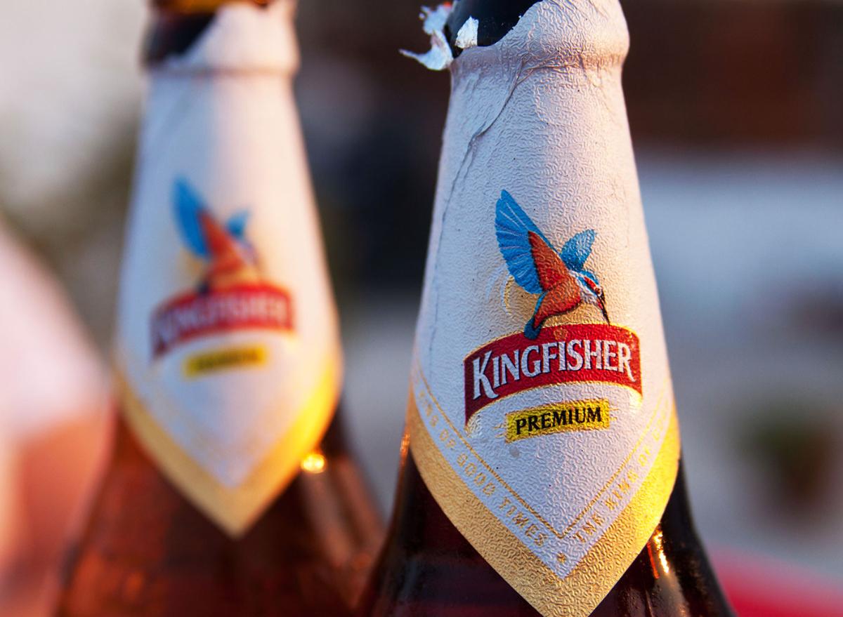 Kingfisher beer bottle neck closeup