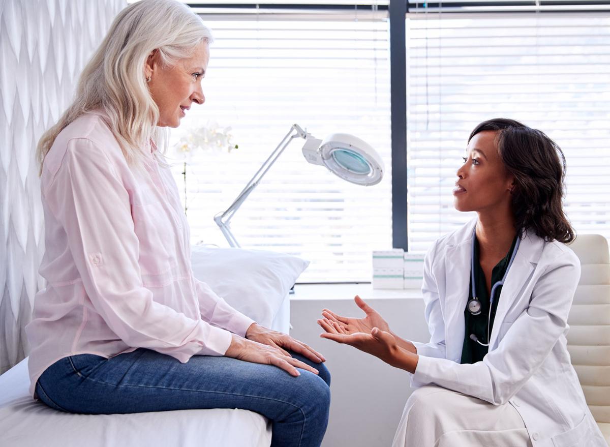 female physician advising female patient