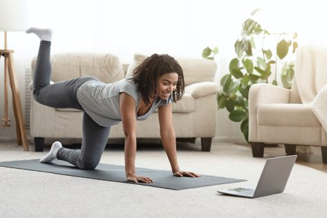woman doing hip exercise at home