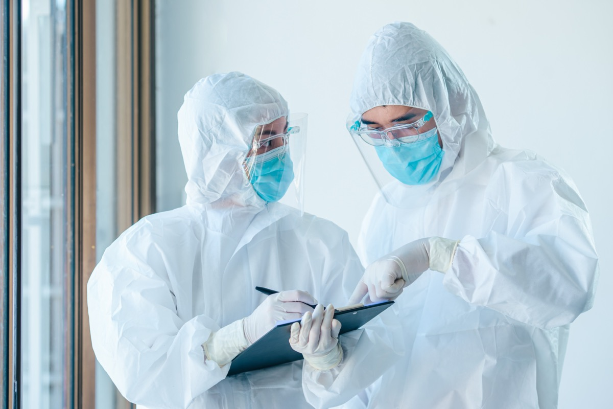 Two doctors wearing personal personal protective equipment