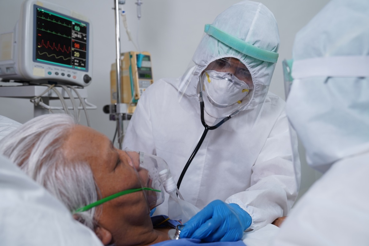 Doctors and nurses are working on corona virus/covid-19 infected patient in the ICU/ hospital.