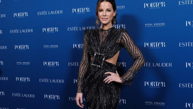 kate beckinsale in black dress with cut out sides on red carpet