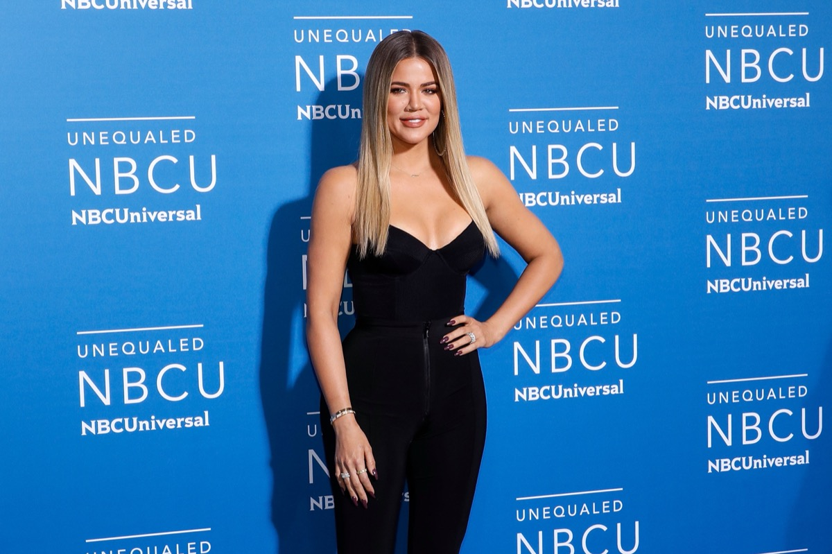khloe kardashian in black jumpsuit on red carpet