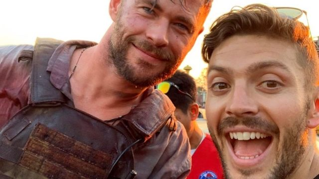 chris hemsworth and luke zocchi posing together outside in instagram screenshot