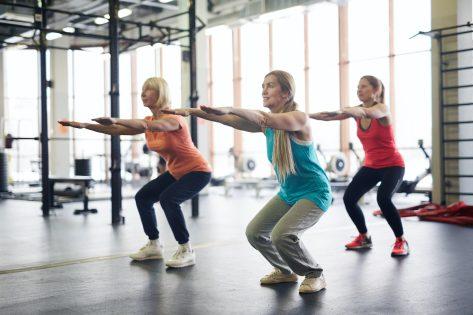 mature women doing squats