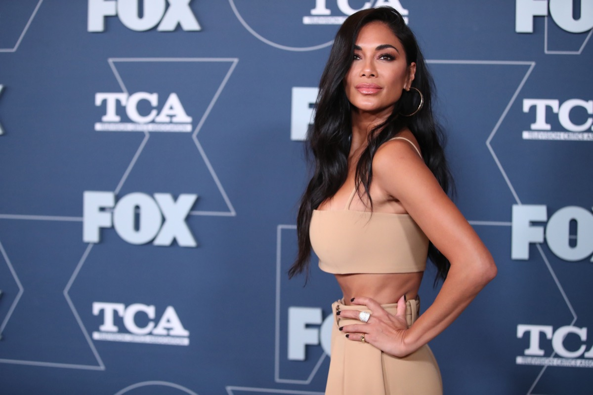nicole scherzinger in tan bandeau top and tan pants on red carpet