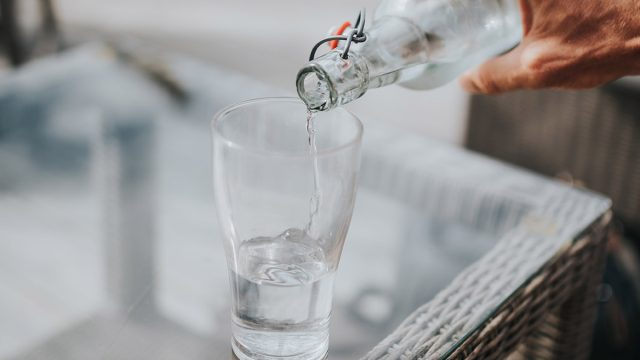 pouring cold water into a glass