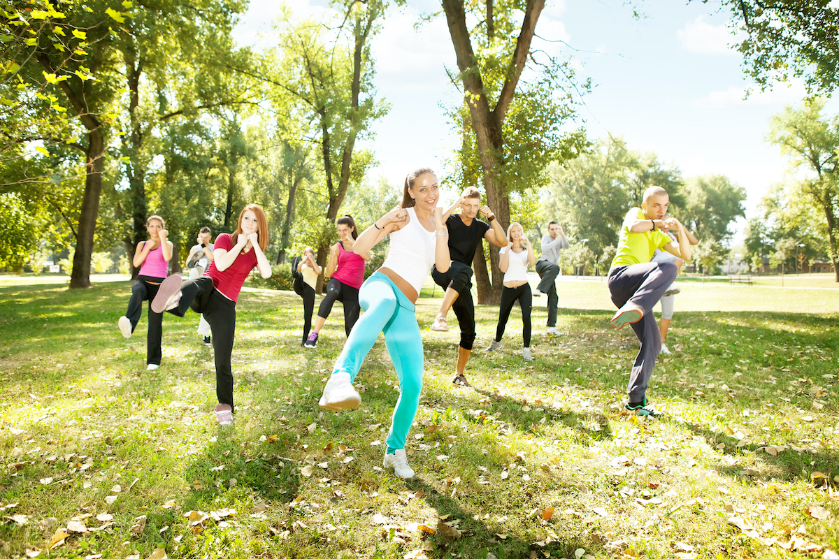 large group of young people training Tae Bo, outdoor