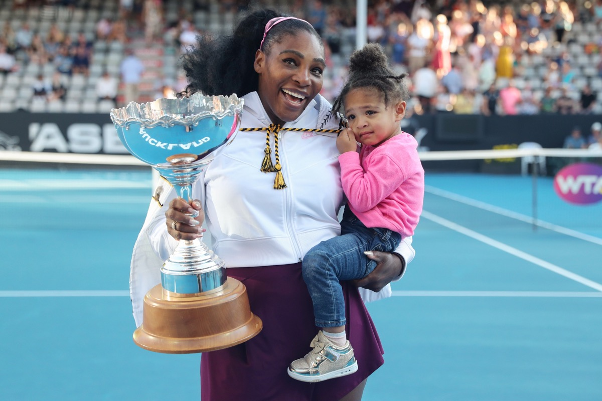 serena williams holding her daughter olympia and a trophy