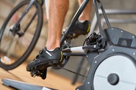 man riding stationary bike