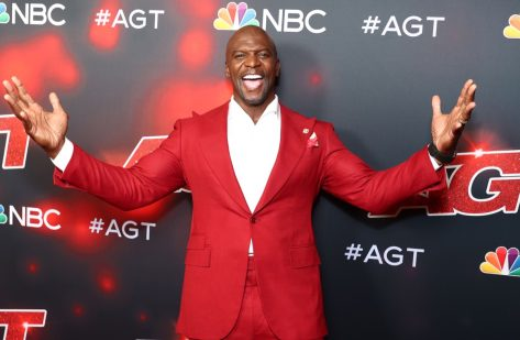 terry crews in red suit on red carpet