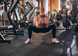 woman dumbbell squat