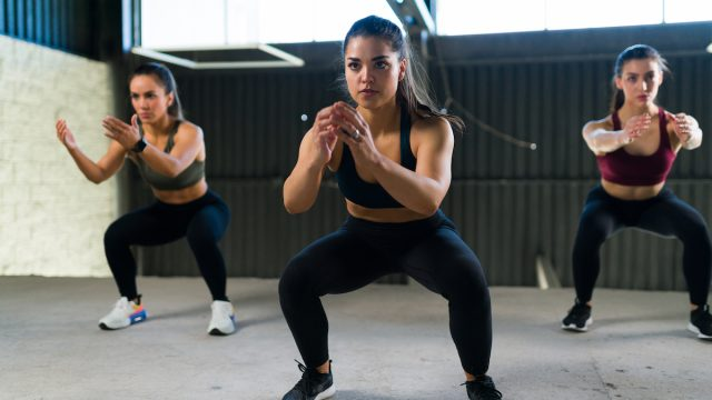Beautiful,Women,Doing,A,Cardio,Hiit,Routine,And,Squatting.,Three