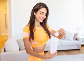 young woman making protein shake