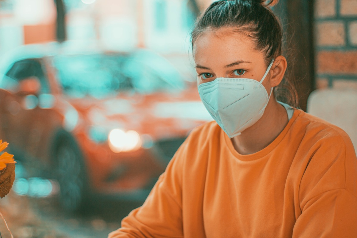Woman in a restaurant with face protection mask kn95.