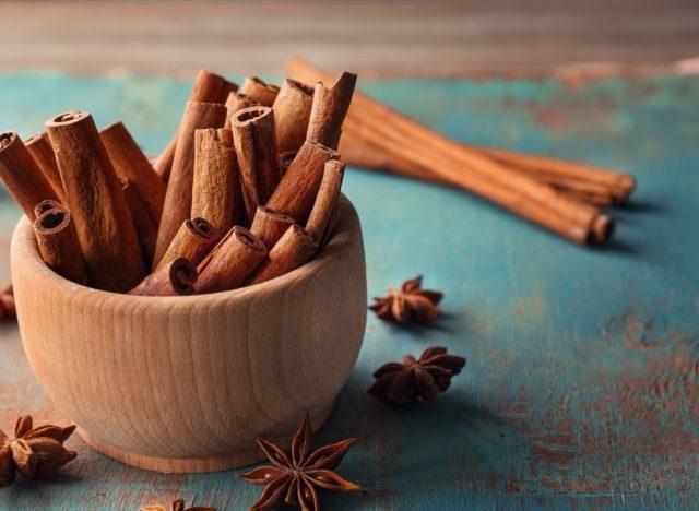 wooden bowl full of cinnamon sticks