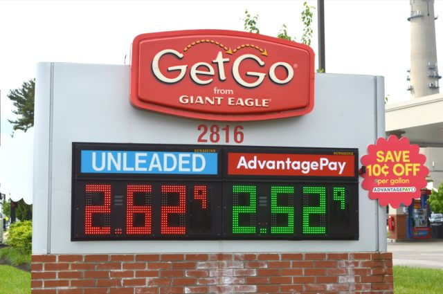 electronic sign displaying gas prices at getgo by giant eagle convenience store in daylight