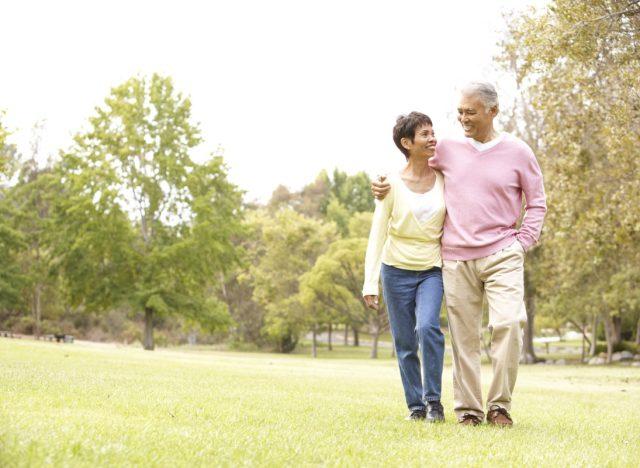 older couple walking outdoors