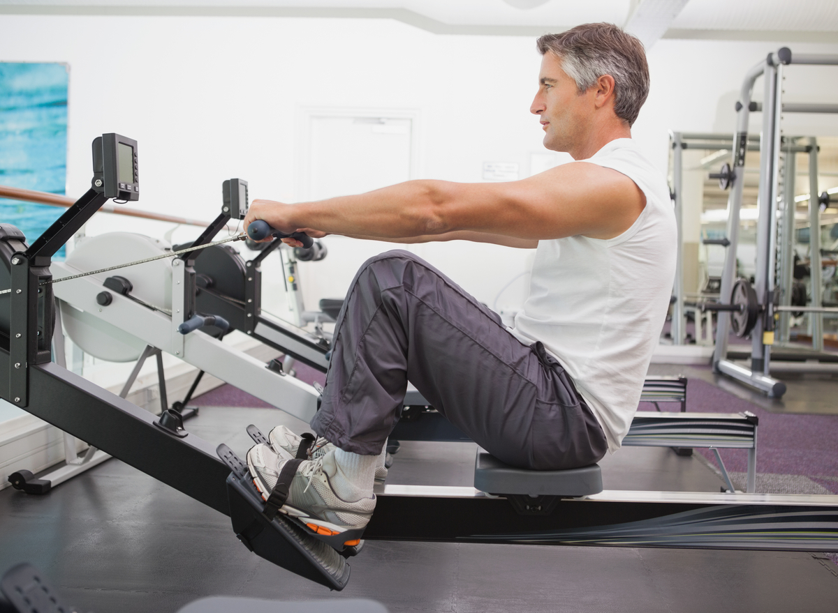 man at the gym on rowing machine