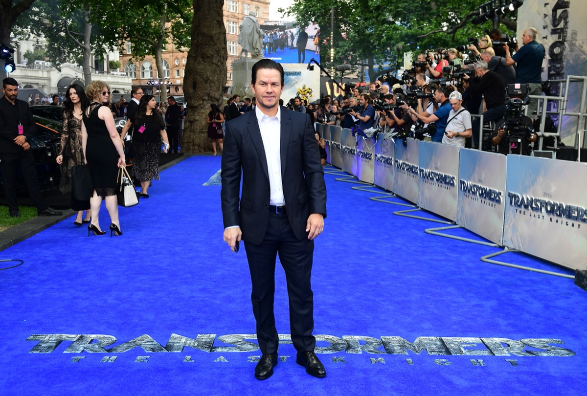 mark wahlberg in black suit on blue carpet at transformers premiere