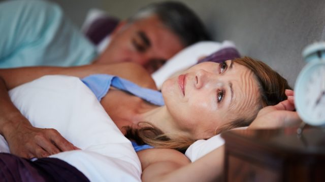 Couple In Bed With Wife Suffering From Insomnia