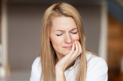 Mature woman feeling strong pain, toothache.