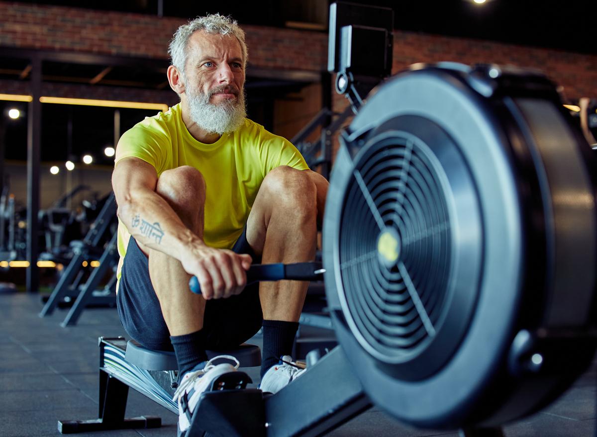 older man rowing machine