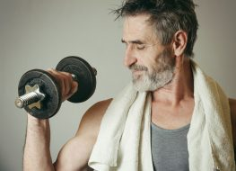 older man working out gym weights