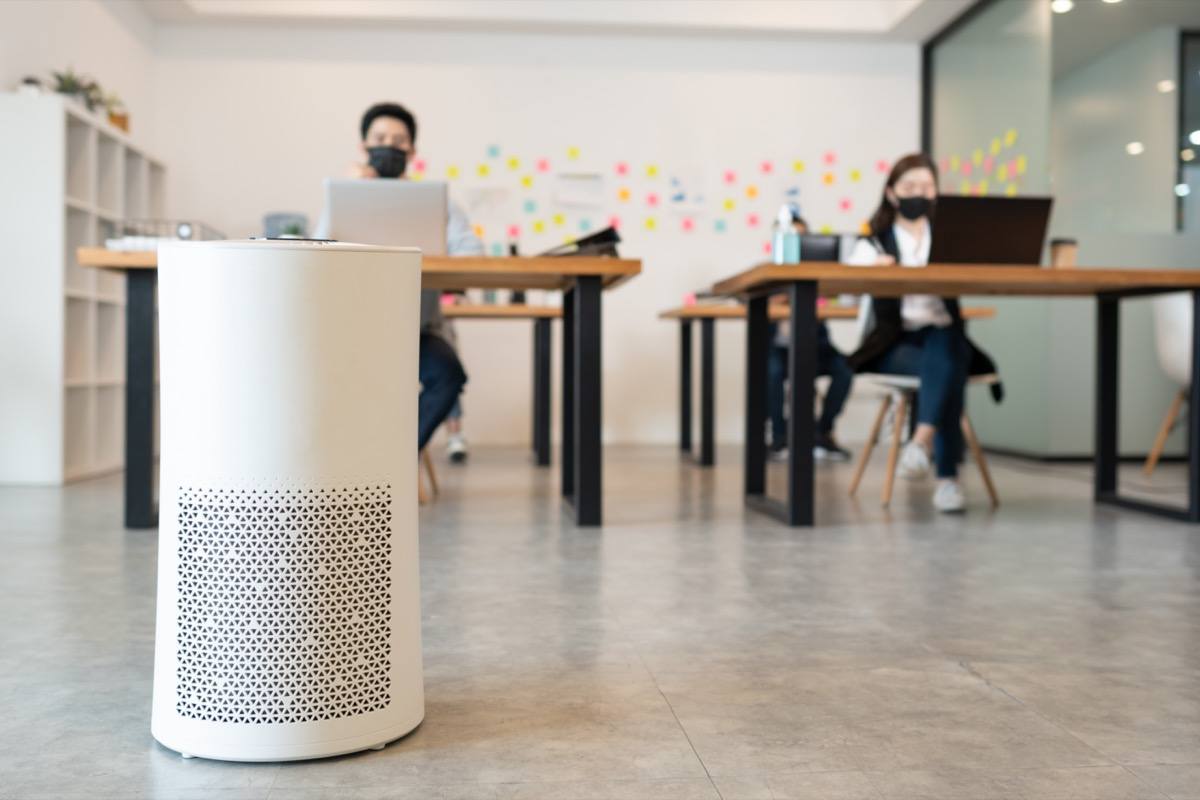 Air purifier in modern office for fresh air and removal dust