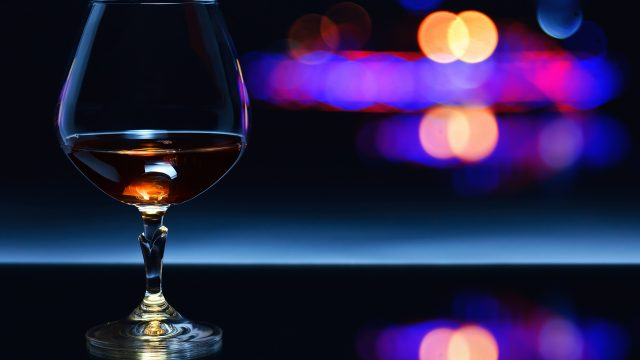 Snifter,With,Brandy,On,A,Dark,Background.