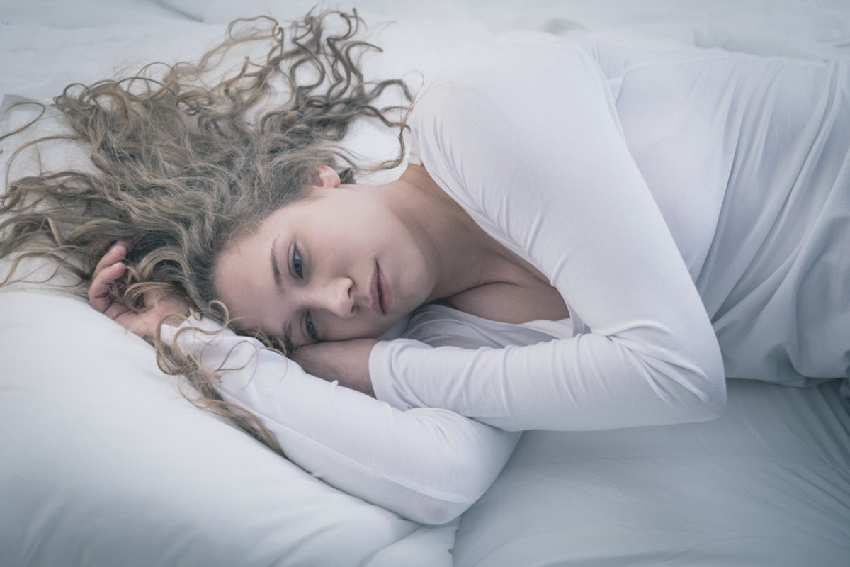 Woman lying at bed.