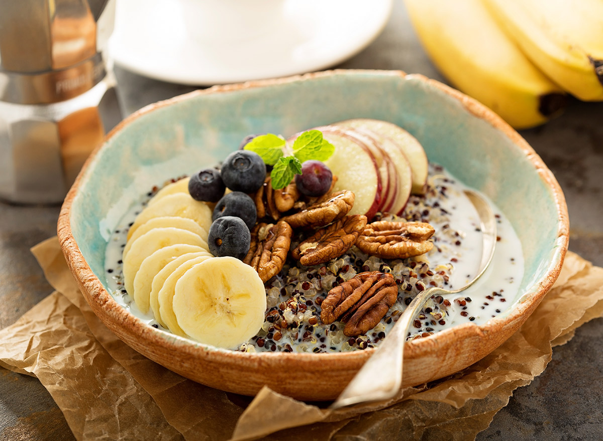 pecans in a breakfast bowl with quinoa and fruit