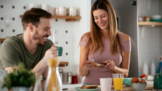 young couple making breakfast in their modern kitchen